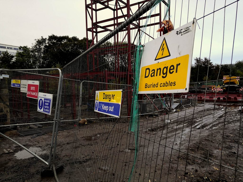 Hazard and warning signs on construction site for new buildings in the UK