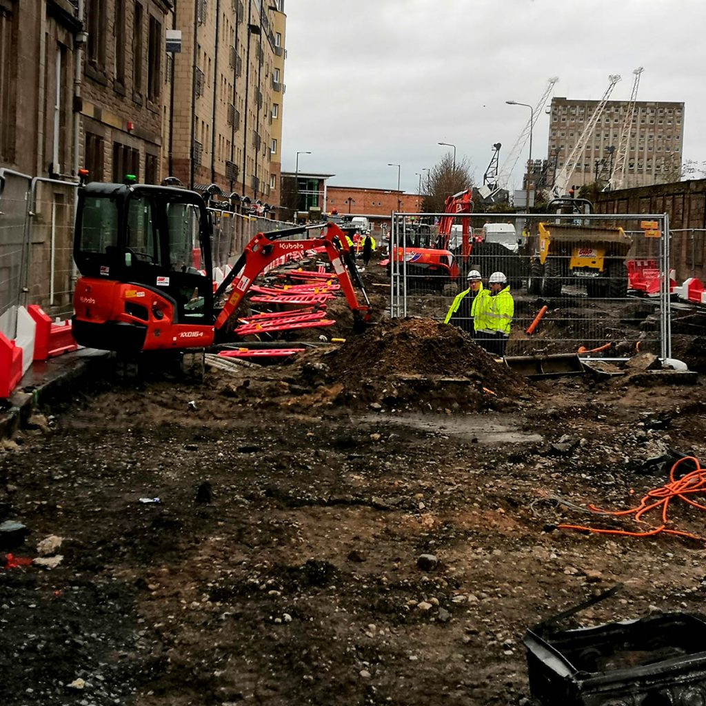 Building work on city road in Scotland with Moving Vehicles