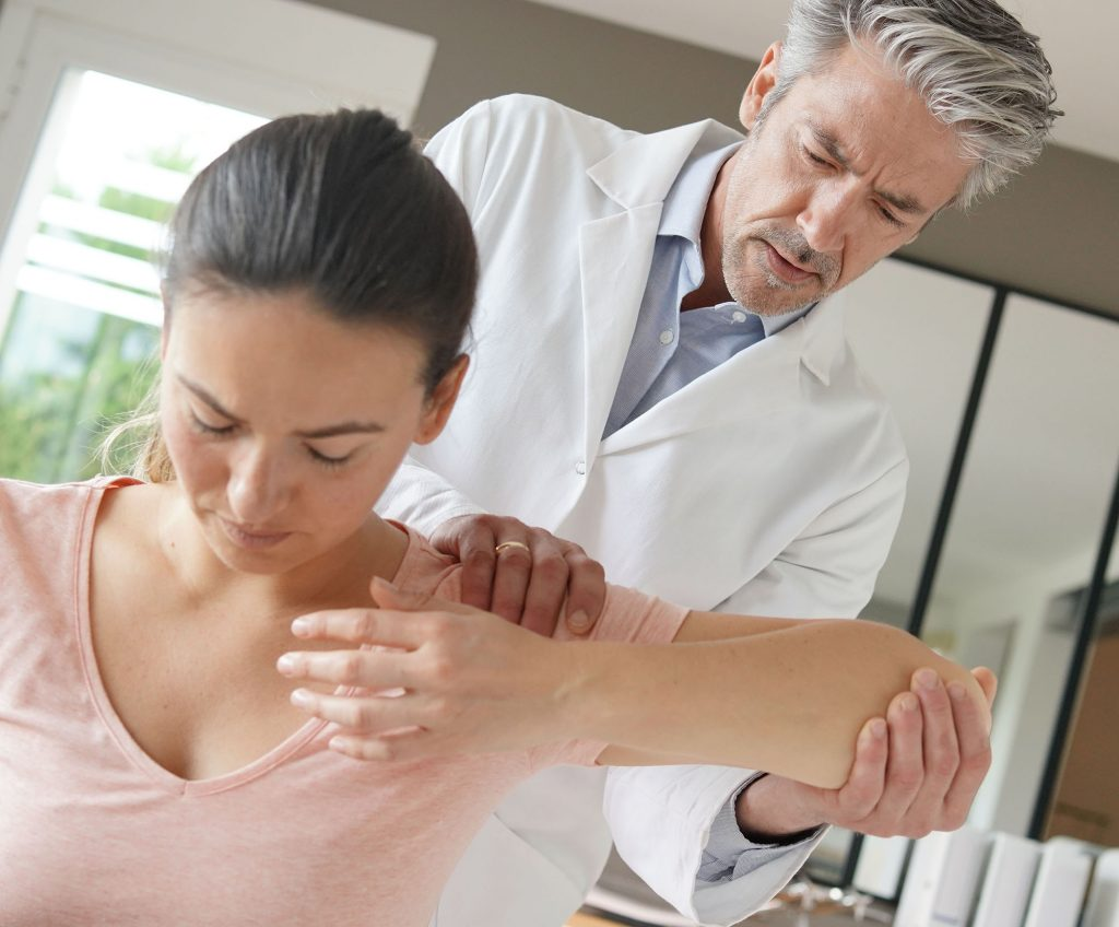 Doctor examines patient with musculoskeletal disorder, healthcare and medical professional - occupational illness