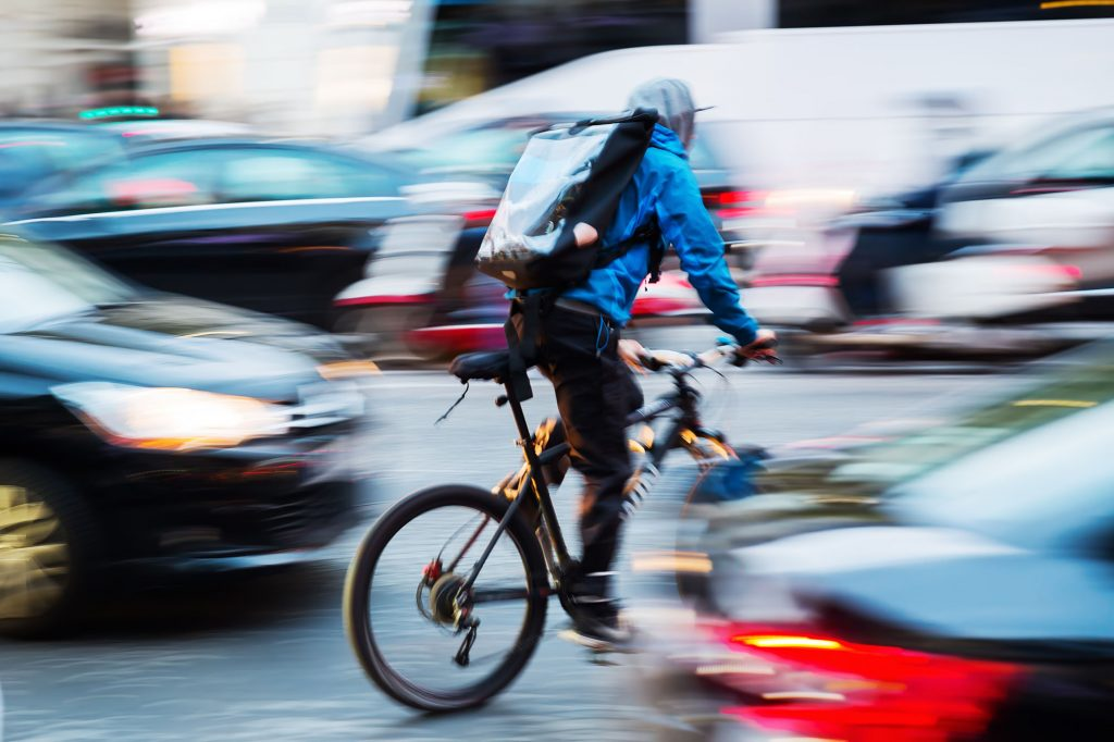 zero-hour gig economy worker cycling with food order - occupational illness